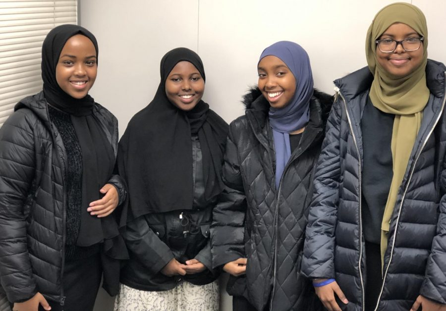 Tartan students Yasmin, Hamdi, Sumeyo and Amal proudly wearing hijabs.